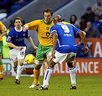 Photo: Chris Ratcliffe.<br />Leicester City v Norwich City. Coca Cola Championship. 31/12/2005.<br />Dean Ashton of Norwich takes on Dion Dublin.