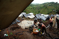 Workers hired by the Colombian government to manually eradicate coca crops wash up and prepare for dinner in their camp after a long day of work, in El Campanario, in a remote area of the southern Colombian state of Nariño, on Thursday, June 21, 2007. (Photo/Scott Dalton)