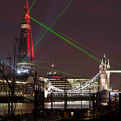 London, UK - 5th July 2012: Renzo Piano's The Shard during the inaugural laser light show. European Union's tallest building fires light beams from the summit to 15 other landmarks across the city. Images available for sale here, Alamy or Demotix