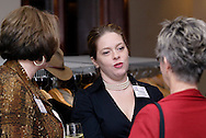 (from left) Joanie Spain of school of advertising art, Teresa Lea Whitley of Elsevier Science and Elaine Middlestetter of Concept Company during the holiday meeting of the American Advertising Federation at the NCR Country Club in Kettering, Thursday, December 15, 2011.