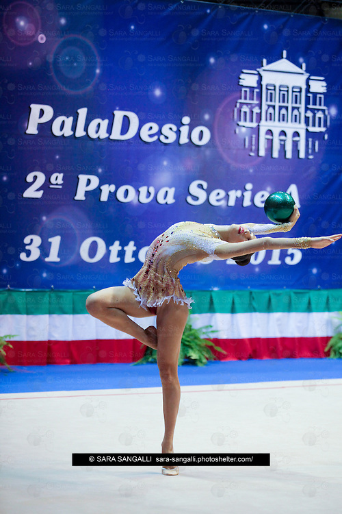 DESIO, ITALY - OCTOBER 31 2015: Giulia Muscolino of Gymnica 96 performs with ball at the italian national rhythmic gymnastic championship. Her score in the apparatus is 11,300. Her team's score is 80,400 and ended up in ninth position.
