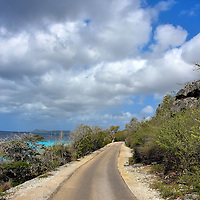 Queen&rsquo;s Highway North of Kralendijk, Bonaire<br /> Before driving along the leeward coast of Bonaire, don&rsquo;t let the name &ldquo;Queen&rsquo;s Highway&rdquo; mislead you. Instead of a busy freeway, this is a narrow sometimes dusty road that hugs the northern shoreline and eventually becomes one-way. You can&rsquo;t get lost, it is easy to pull over and the pace is definitely slow. But with such beautiful scenery, who wants to go fast?