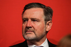 © Licensed to London News Pictures. 09/05/2017. Manchester, UK. Shadow Secretary of State for International Trade Barry Gardiner watches on as Labour Leader Jeremy Corbyn addresses supporters and the media at a rally in Manchester to launch the party's general election election campaign. Photo credit : Ian Hinchliffe/LNP