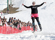 Warwick, New York - A skier flies through the air after crossing the water during the annual Spring Rally at Mount Peter Ski and Ride on March 21, 2010.