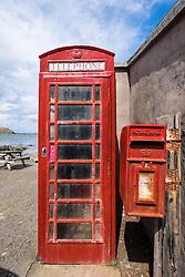 Red telephone box in Pennan village on coast in Aberdeenshire Scotland
