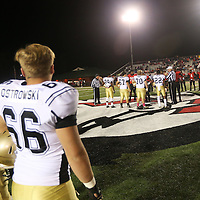 Lauren Wood | Buy at photos.djournal.com<br /> Amory and Corinth players line up for the coin toss before the start of Friday night's game at Corinth.