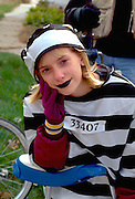 Girl age 14 in prisoner costume at Anoka Halloween Festival Parade.  Anoka Minnesota USA
