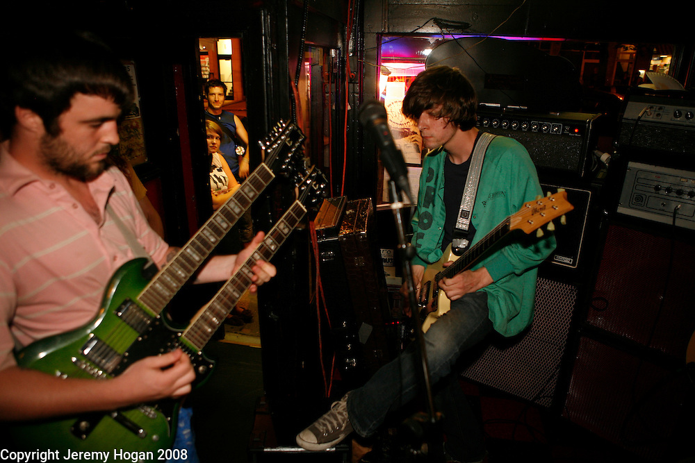 The band calling themselves, UGH God, of Philadelphia, Pennsylvania, plays a show at Rockit's Pizza restaurant in Bloomington, Indiana.