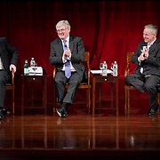 February 9, 2012 - New York, NY :.Taoiseach (Irish Prime Minister) Enda Kenny, left, answers a question during an 'Invest in Ireland' forum at the Kimmel Center at New York University on Thursday, Feb. 9, 2012. To his right are Tanaiste (deputy Irish Prime Minister) Eamon Gilmore, center, and.Irish Minister for Jobs, Enterprise and Innovation Richard Bruton. .CREDIT: Karsten Moran for The Irish Independent