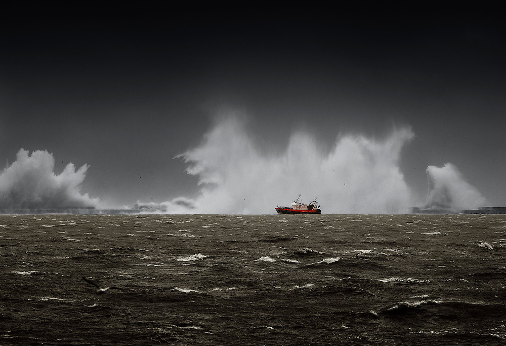 French trawler entering the harbour in Boulogne-sur-Mer, during one of the biggest storms of 2013.<br /> <br /> Even with modern boats and equipment, crews still have to work gruelling shifts in perilous conditions, making the job of a deep-sea fisherman one of the most dangerous professions in the world.