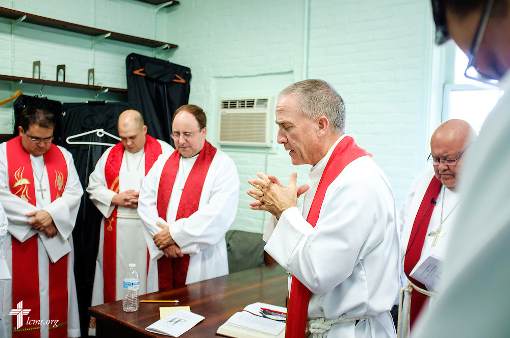 The Rev. Mark Barz, third vice president of the Texas District and pastor of Crown of Life Lutheran Church, San Antonio, Texas, prays before the installation service for the Rev. Dr. Antonio Lopez (seen to the right of Barz), new national missionary pastor at El Calvario Lutheran Church on Sunday, July 31, 2016, at the parish in Brownsville, Texas. LCMS Communications/Erik M. Lunsford