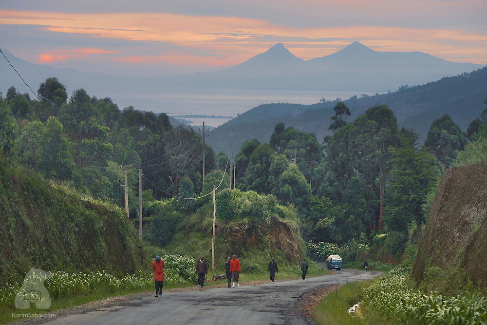 Villagers on a road to Lake Kivu, near Kibuye, Rwanda. The distant hills are located in the region of Kavumu in the Democratic Republic of Congo.
