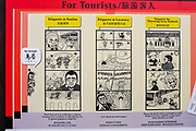 Manga style sign telling tourists how to behave in at the train station, while using the lavatory, and how to through away waste, Kyoto, Japan