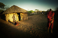 Tanzania, traditional Maasai life. The Boma, settlement, is the Maasai equivalent of a household. The cattle are enclosed in the centre by a circular wall. Around it several houses are arranged in a specific order, which in turn are encircled by an outer wall. The women are in charge of their house, the patriarch runs the Boma at large.