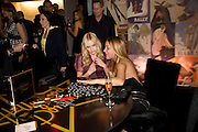 KATE BOSWORTH HAVING DOMINOES EXPLAINED TO HER BY  DAYA FERNANDEZ, Vanity fair and Bally's 'Hollywood Domino' party to benefit The Art of Elysium at the Andaz Hotel, Sunset Boulevard. West Hollywood. 20 February 2009 *** Local Caption *** -DO NOT ARCHIVE-© Copyright Photograph by Dafydd Jones. 248 Clapham Rd. London SW9 0PZ. Tel 0207 820 0771. www.dafjones.com.<br /> KATE BOSWORTH HAVING DOMINOES EXPLAINED TO HER BY  DAYA FERNANDEZ, Vanity fair and Bally's 'Hollywood Domino' party to benefit The Art of Elysium at the Andaz Hotel, Sunset Boulevard. West Hollywood. 20 February 2009