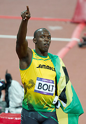 © Licensed to London News Pictures. 05/08/2012. London,UK.Jamaica's Usaine Bolt celebrates after wining the 100m final, breaking the Olympic record, , at the Olympic Stadium, in London, during the London 2012 Olympic Games. Usaine Bolt won the 100m final, breaking the Olympic record. Photo credit : Bogdan Maran/LNP/BPA