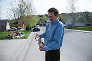 On May 2, 2104, an unidentified neighbor and friend of the host family of Diren Dede, a German exchange student who was shot and killed by another neighbor, delivers the newly printed stickers honoring the slain student that will be used to raise money to help Dede's family pay for expenses. #4 was Dede's number on the Big Sky High School soccer team.
