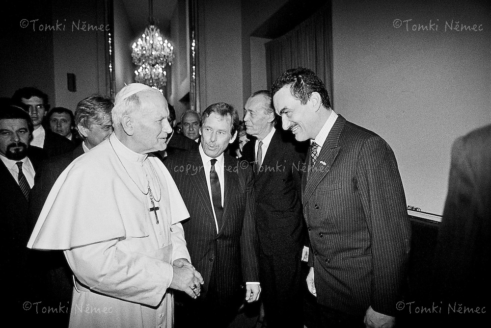 Pope John Paul II is walking in the cathedral of Svaty Vit in Prague a few weeks after the Velvet revolution in Czechoslovakia. Karl Schwarzenberg together with Vaclav Havel and John Paul II.