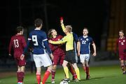 10th November 2017, McDiarmid Park, Perth, Scotland, UEFA Under-21 European Championships Qualifier, Scotland versus Latvia; Referee Jergen Burchardt red cards Latvia's Ingars Stuglis