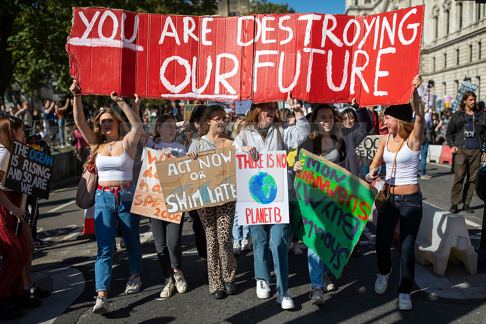 © Licensed to London News Pictures. 20/09/2019. London, UK. Students join demonstrations in Westminster as part of the global climate strike. Protests are being led by young people in cities around the world, with millions expected to attend. Photo credit: Rob Pinney/LNP