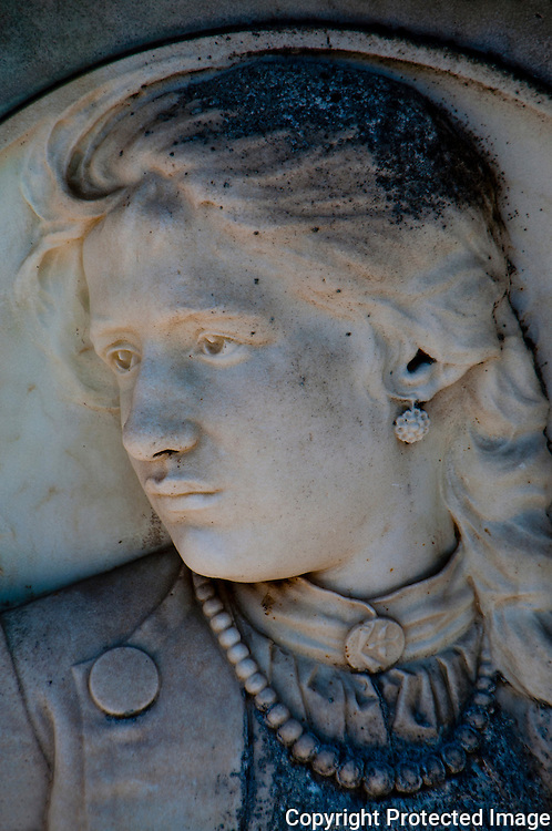 Close-up of a marble bas relief portrait of a young woman in Isola San Michel in Venice, Italy.