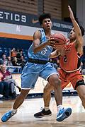 San Diego Toreros guard Noel Coleman (3) attempts to drive past Cal State Fullerton Titans guard Daniel Venzant (2) during an NCAA basketball game, Wednesday, Dec. 11, 2019, in Fullerton, Calif. San Diego defeated CSUF 66-54. (Jon Endow/Image of Sport)