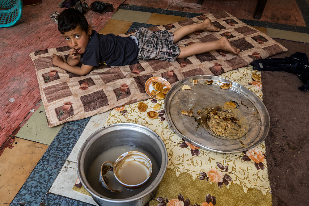 A child dines on the rations that he has had for only the last several weeks. West Mosul, Iraq. May 9, 2017. (Photo by Gabriel Romero ©2017)