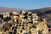 Town of Urgup on Temenni Tepesi or Wish Hill, in Nevsehir province, Cappadocia, Central Anatolia, Turkey. Urgup was one of the first areas to be settled in the region and is now a tourist centre and home to the Cappadocian wine trade. Many of the houses here are built in or above caves cut into the soft volcanic rock. This area forms part of the Goreme National Park and the Rock Sites of Cappadocia UNESCO World Heritage Site. Picture by Manuel Cohen