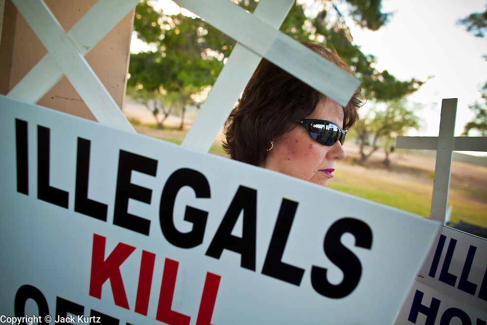 19 MAY 2011 - PHOENIX, AZ: Jill (who wouldn't give her last name) holds up sign supporting Russell Pearce's anti-illegal immigrant laws during a rally in Paradise Valley Park in Phoenix Thursday evening. About 100 people attended the rally, which was to support some of the state's most conservative politicians including Joe Arpaio, Russell Pearce and John Kavanagh. The rally was sponsored by the Maricopa County Republican Party and a Tea Party group.     PHOTO BY JACK KURTZ