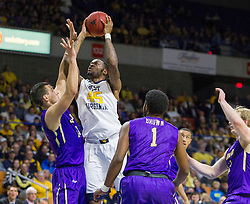 Nov 16, 2015; Charleston, WV, USA; West Virginia Mountaineers forward Elijah Macon shoots in the lane during the first half against the James Madison Dukes at the Charleston Civic Center. Mandatory Credit: Ben Queen-USA TODAY Sports