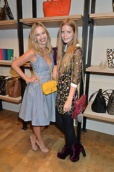 Left to right, MARISSA HERMER and KATIE READMAN at a lunch hosted by Alice Naylor-Leyland and Tamara Beckwith in celebration of the Coach 2015 collection held at Coach, New Bond Street, London on 18th September 2014.