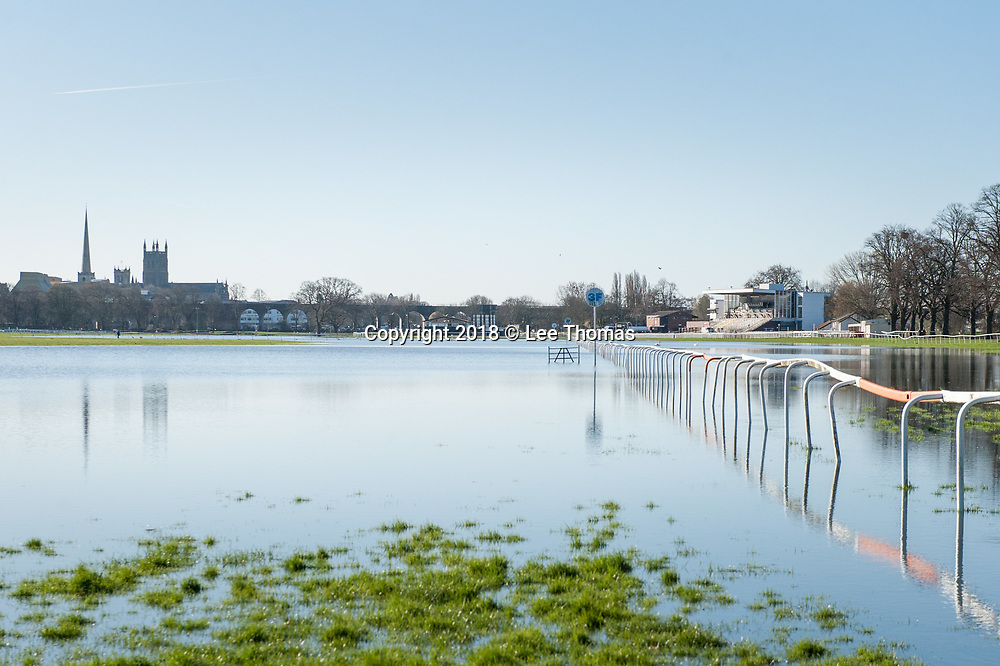 Worcester, Worcestershire, UK. 5th April 2018. Despite a respite in the weather, flood waters remain high in Worcester with the race course and county cricket club partially covered in the wet stuff. Pictured:  Worcester's Pitchcroft, home of the city's horse racing meetings remains partially submerged. // Lee Thomas, Tel. 07784142973. Email: leepthomas@gmail.com  www.leept.co.uk (0000635435)