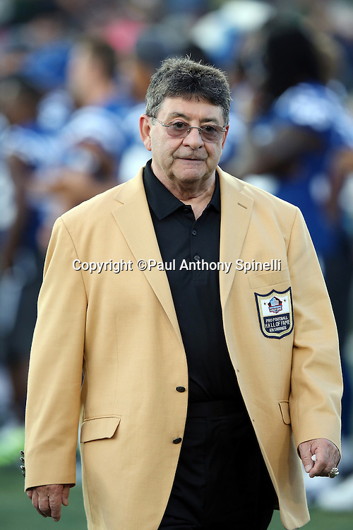 """Former owner of the San Francisco 49ers Edward J. """"Eddie"""" DeBartolo Jr. is announced over the public address system as he walks onto the field as a new member of the Pro Football Hall of Fame before the Green Bay Packers 2016 NFL Pro Football Hall of Fame preseason football game against the Indianapolis Colts on Sunday, Aug. 7, 2016 in Canton, Ohio. The game was canceled for player safety reasons due to the condition of the paint on the turf field. (©Paul Anthony Spinelli)"""