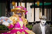 Woman in Carnival dress and Charlie Chaplin mime, Venice, Veneto, Italy
