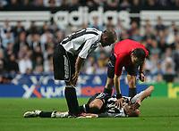 Photo: Andrew Unwin.<br /> Newcastle United v Fenerbahce. UEFA Cup. 19/10/2006.<br /> The referee, Grzegorz Gilewski, checks as Newcastle's Antoine Sibierski lies injured.