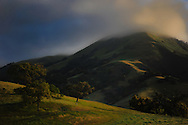 The rolling hills of Southern California as the clouds rest on the peak