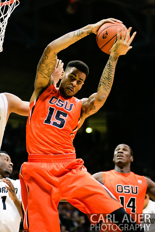January 2nd, 2014:  Oregon State Beavers junior forward Eric Moreland (15) grabs a rebound in the second half of the NCAA Basketball game between the Oregon State Beavers and the University of Colorado Buffaloes at the Coors Events Center in Boulder, Colorado