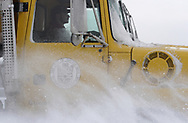 Snow swirls around a city of Dayton snowplow, as he passes the University of Dayton Arena, January 21, 2007.