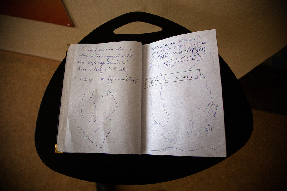 "A guest book signed with the words ""Gypsies to the Gas!"" at the memorial center for the Roma internment camp at Lety, Czech Republic."
