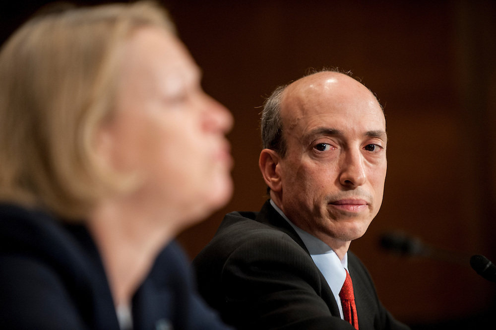 Gary Gensler, chairman of the Commodity Futures Trading Commission, looks on as Mary Schapiro, chairman of the Securities and Exchange Commission testifies before the Senate Banking, Housing and Urban Affairs Committee on Tuesday on Captiol Hill. The committee held the hearing about implementing derivatives reform and reducing systemic risk and improving market oversight.