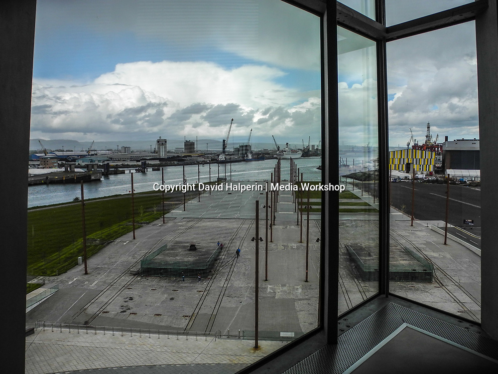 Poles mark the sites of drydocks where the Titanic and its sister ship Olympic were built. Not e human figures for scale. View from inside Titanic Belfast exhibition.