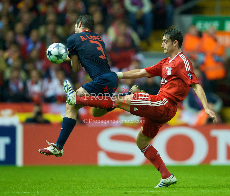 LIVERPOOL, ENGLAND - Tuesday, November 4, 2008: Liverpool's Albert Riera and Club Atletico de Madrid's Antonio Lopez during the UEFA Champions League Group D match at Anfield. (Photo by David Rawcliffe/Propaganda)