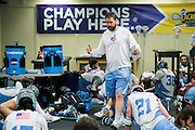 05/24/2014 - Baltimore, Md. - Tufts head coach Mike Daly gives his players a pre-practice talk in the Baltimore Ravens locker room at M&T Stadium in preparation for the NCAA Division III National Championship on May 24, 2014. (Kelvin Ma/Tufts University)