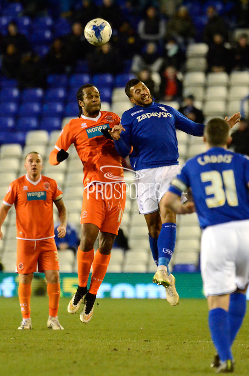 David Davis wins a header during the Sky Bet Championship match between Birmingham City and Blackpool at St Andrews, Birmingham, England on 4 March 2015. Photo by Alan Franklin.
