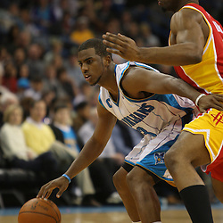 Jan 02, 2010; New Orleans, LA, USA; New Orleans Hornets guard Chris Paul (3) drives in against Houston Rockets forward Carl Landry (14) during the third quarter at the New Orleans Arena. Mandatory Credit: Derick E. Hingle-US PRESSWIRE