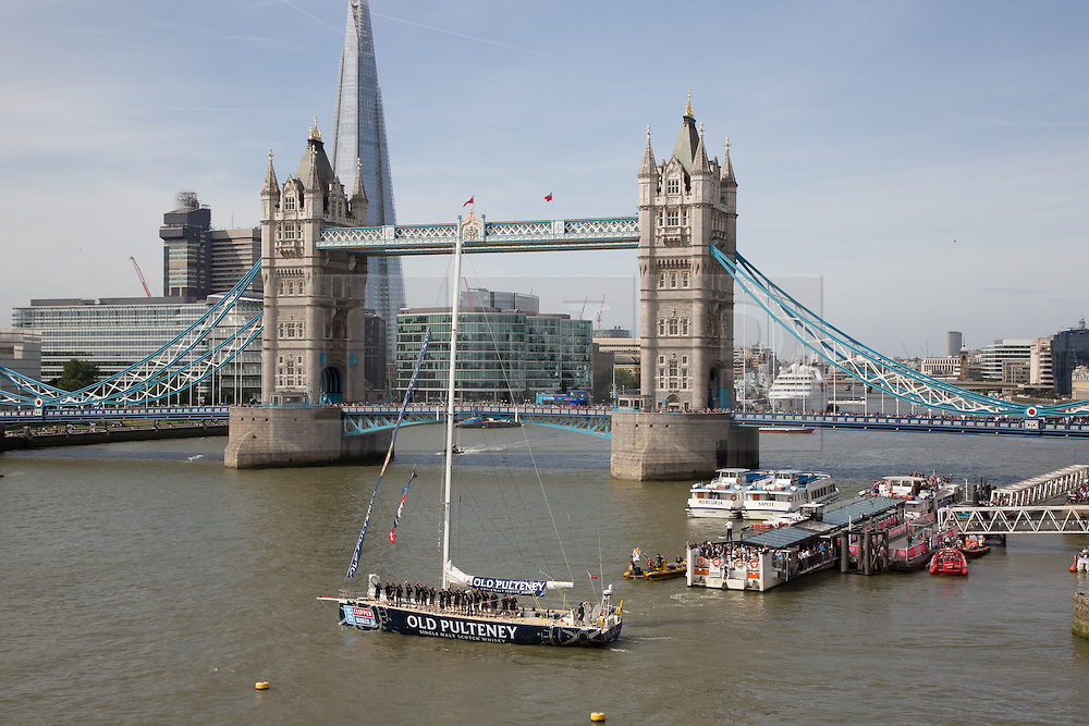 © Licensed to London News Pictures. 01/09/2013. London, UK. The Old Pulteney Clipper leaves St Katharine Docks and passes in front of Tower Bridge for the 2013-14 Round the World Yacht Race on the River Thames. This is the first time London has hosted a round the world sailing race in more than 40 years.12 yachts ail begin the 40,000 mile, 11 leg race. They will visit six continents and the race will take 11 months to complete. 395 of the 670 crew members are from the UK, 87 come from London. Each vessel has an amateur crew under the command of a professional skipper. Photo credit : Vickie Flores/LNP