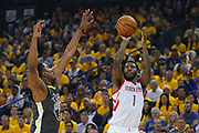April 30, 2019; Oakland, CA, USA; Houston Rockets guard Iman Shumpert (1) shoots the basketball against Golden State Warriors center Kevon Looney (5) during the first quarter in game two of the second round of the 2019 NBA Playoffs at Oracle Arena.