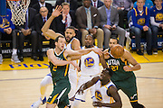 Utah Jazz forward Joe Ingles (2) passes the ball against the Golden State Warriors defense at Oracle Arena in Oakland, Calif., on December 20, 2016. (Stan Olszewski/Special to S.F. Examiner)