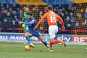 George Francomb of AFC Wimbledon escapes from Paddy McCourt of Luton Town during the Sky Bet League 2 match between AFC Wimbledon and Luton Town at the Cherry Red Records Stadium, Kingston, England on 13 February 2016. Photo by Stuart Butcher.