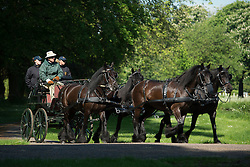 ©London News Pictures. 15/05/2014. Windsor, UK.  HRH Prince Philip, Duke of Edinburgh, driving a four horse drawn carriage through the grounds of Windsor Great Park on day two of the Royal Windsor Horse Show, set in the grounds of Windsor Castle. Photo credit: Ben Cawthra/LNP